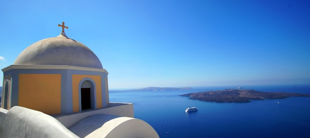 Panoramic view of the caldera with cruise ship in santorini