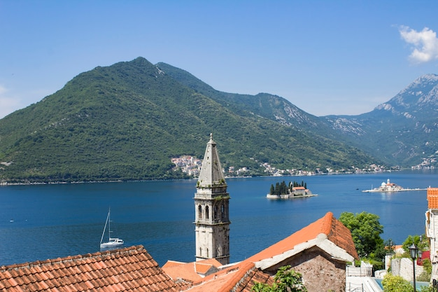 Panoramic view of the city, islands and bay on the sunny day. perast. montenegro.