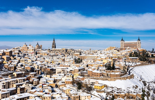 Panoramic view of the city of toledo after the filomena snow storm. urban snowy landscape of the city. Premium Photo