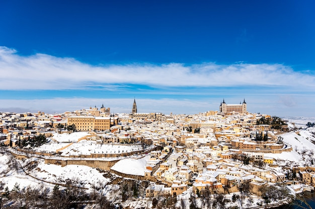 Panoramic view of the city of toledo after the filomena snow storm. urban snowy landscape of the city.