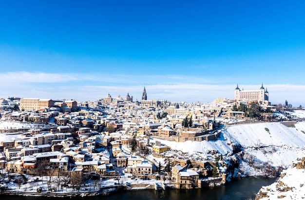 Panoramic view of the city of toledo covered by snow.