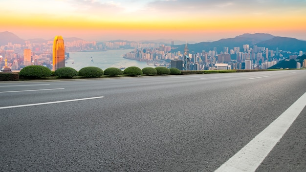 Panoramic view of empty road in city