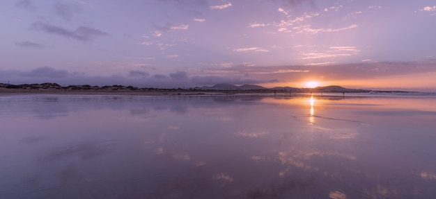 Panoramic view of famara beach at sunset in lanzarote