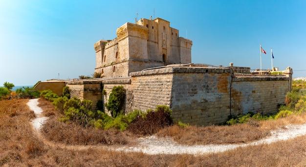 Panoramic view of fort san lucian near marsaxlokk on a sunny day, malta
