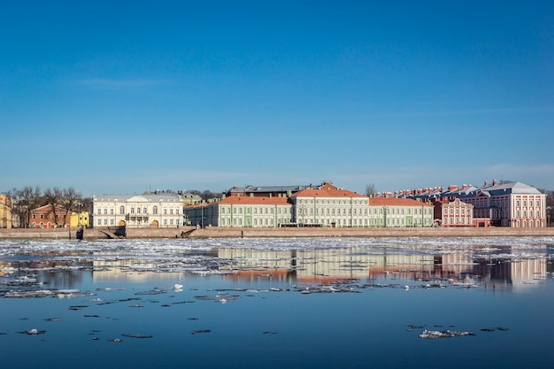 Panoramic view from neva river on cityscape and architecture of city,  spring ice drift, saint petersburg, russia.