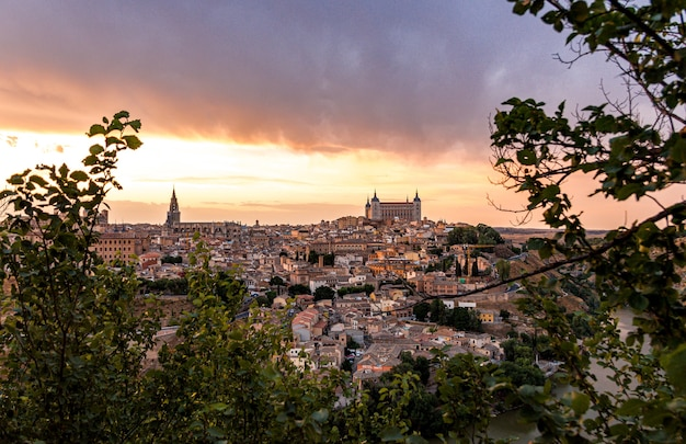 Panoramic view of the historic city of toledo on a cloudy day