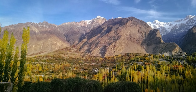 Panoramic view of hunza valley in autumn with snow capped ultar sar mountain in karakoram range.