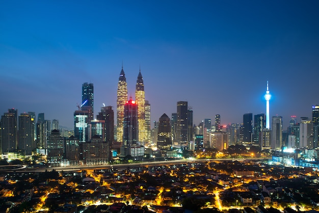 Panoramic view of kuala lumpur city skyline during sunrise viewing skyscrapers building