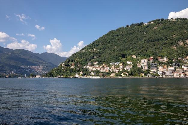 Panoramic view of lake como (lago di como) is a lake of glacial origin in lombardy, italy. summer day and dramatic blue sky
