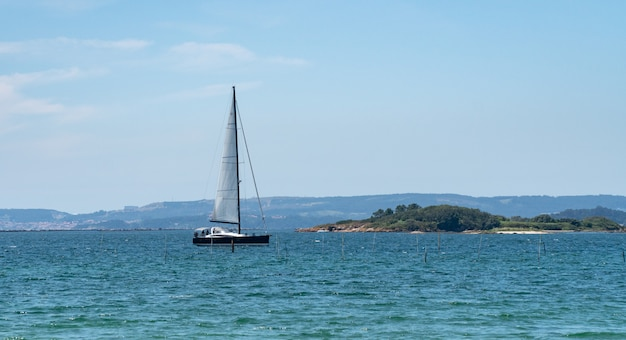 Panoramic view of a luxury yatch sailing in the sea. rias baixas sea, galicia, spain