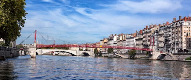 Panoramic view of lyon with saone river and famous red footbridge