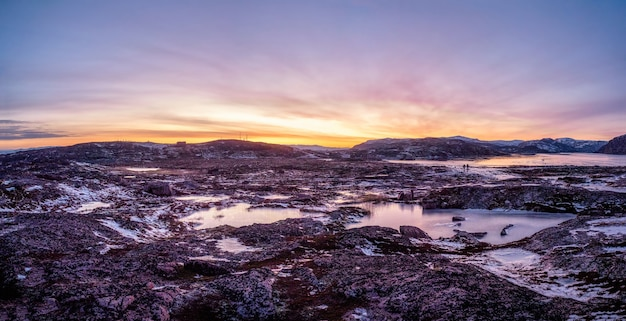 Panoramic view of magenta winter dawn. the icy landscape and mou