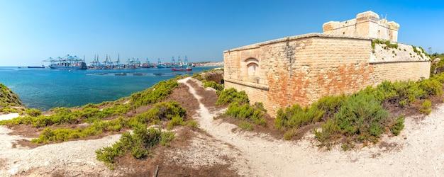 Panoramic view of malta freeport and fort san lucian near marsaxlokk on a sunny day, malta