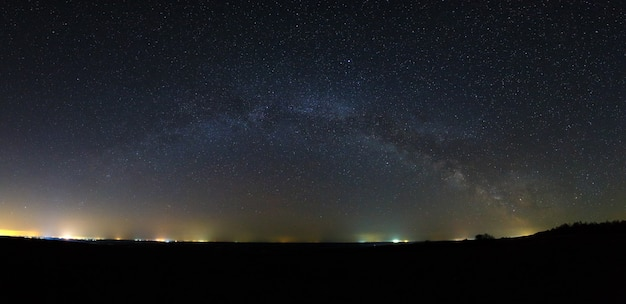 Panoramic view of the milky way galaxy in the night sky with bright stars