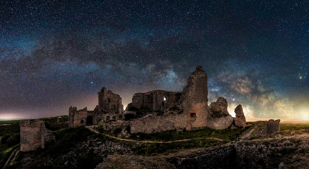 Panoramic view of a night landscape with the arch of milky way in spain