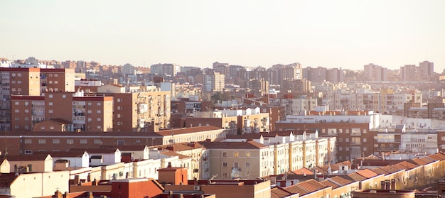 Panoramic view of the rooftops of a city. madrid, spain. space for text.