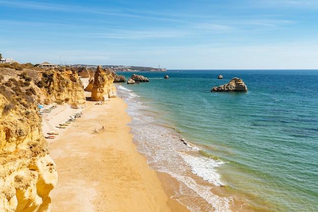Panoramic view of three castles beach in portimao, portuguese algarve, portugal