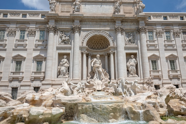 Panoramic view of trevi fountain in the trevi district in rome, italy. it designed by italian architect nicola salvi and completed by giuseppe pannini