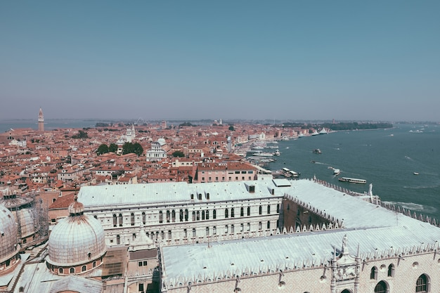 Panoramic view of venice city with historic buildings and coast from st. mark's campanile. landscape of summer day and sunny blue sky