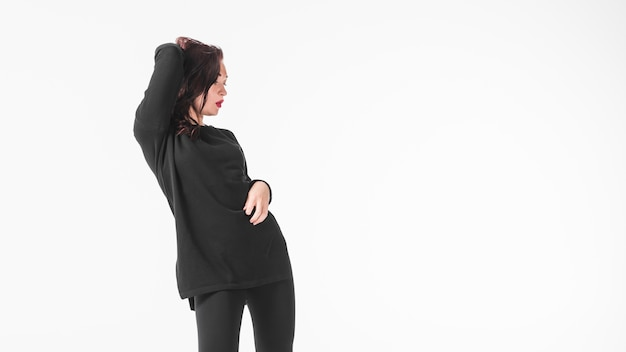 Panoramic view of woman dancing against white background