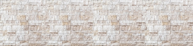 Panoramic wide angle brown white beige travertine wall brick wall art concrete or stone texture background