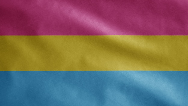 Pansexuality flag waving in the wind. close up of pansexual template blowing, soft and smooth silk. cloth fabric texture ensign background.