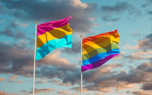 空の背景に全性愛のプライドとlgbtの旗
