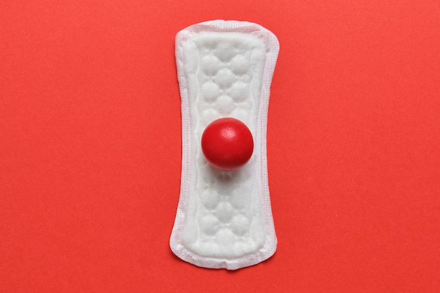 Panty liners on red with an abstract spot of blood