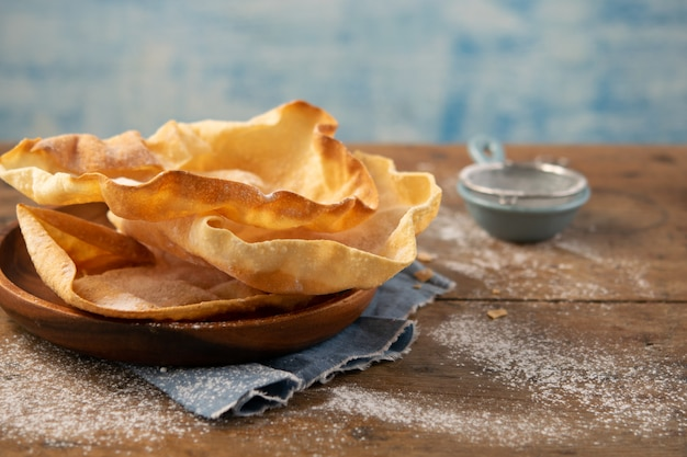 Papadum or papad traditional indian food, vegetarian bread from lentils or beans. food popular in nepalese, pakistani, indian and bangladeshi cuisines.