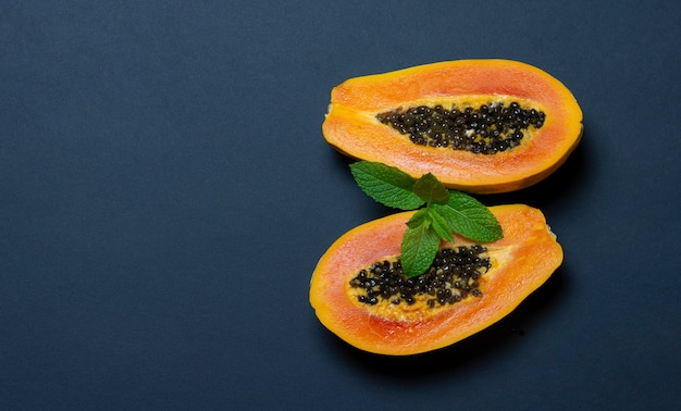 Papaya on bluish dark