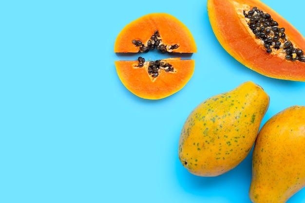 Papaya fruit on blue background. top view
