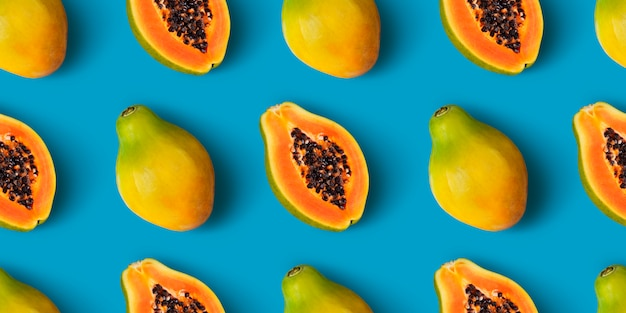 Papaya fruit seamless pattern on blue color