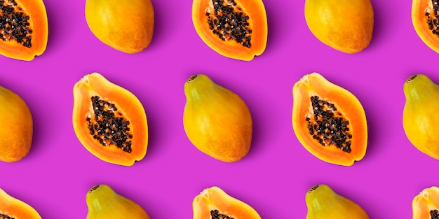 Papaya fruit seamless pattern on purple background