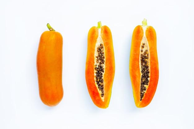 Papaya fruit on white.