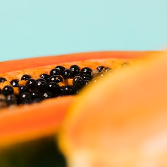 Papaya fruit with blurred glass of water