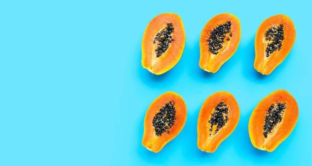 Papaya fruits on blue background. top view