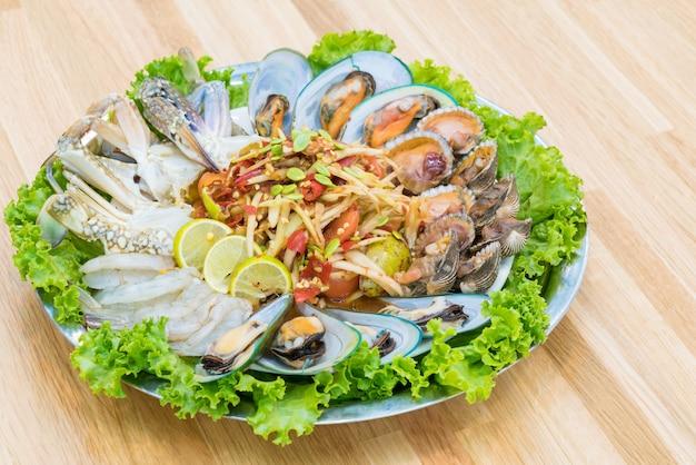 Papaya salad with blue swimming crab, green mussel and shrimp.