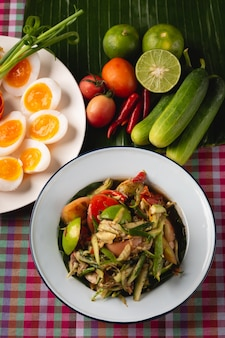 Papaya salad with boiled egg, thai esan local food, thailand