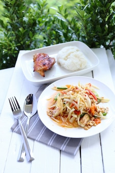 Papaya salad with chicken grilled and sticky rice