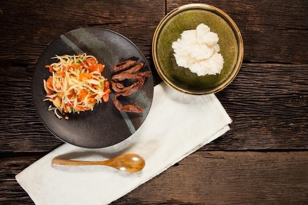 Papaya salad with rice stick and grill pork