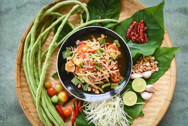 Papaya salad with yardlong bean herbs and spicy ingredients