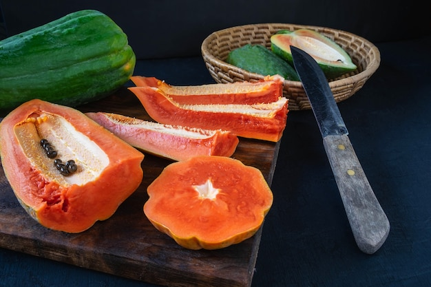 Papaya. tropical fruits. on a wooden background