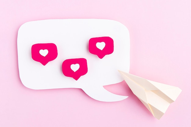 Paper airplane with heart icons