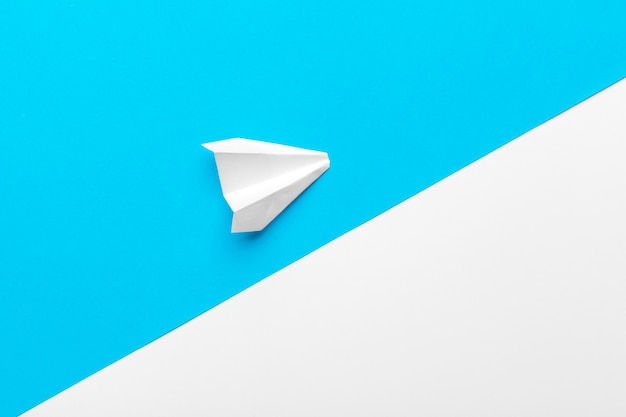 Paper airplanes on pastel colored background. childhood, freedom and diversity concept
