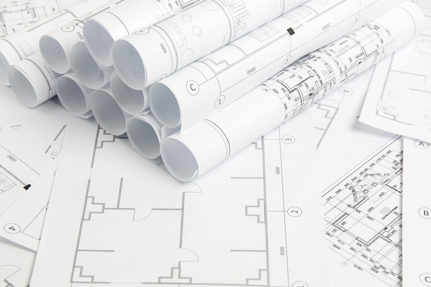 Paper architectural drawings and blueprint. engineering blueprint