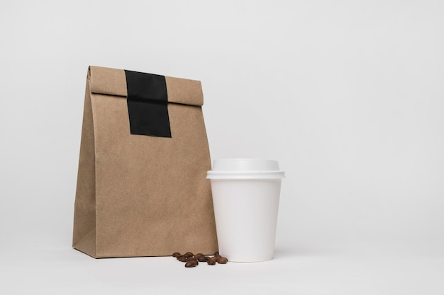 Paper bag and coffee cup arrangement