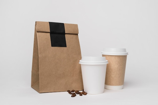 Paper bag and coffee cups arrangement