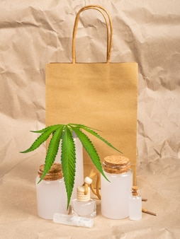 Paper bag and cosmetics made from hemp, cannabis body care cosmetic set.