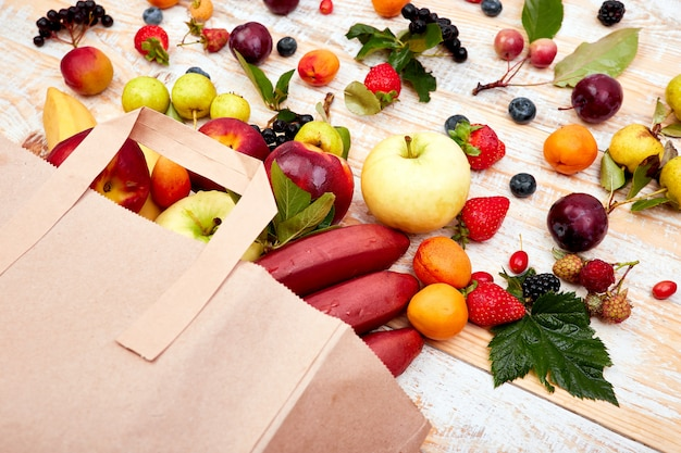 Paper bag of different health fruits food