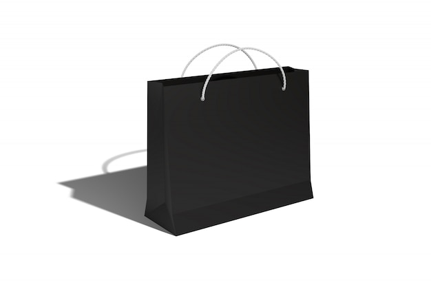 Paper bag from cardboard for shopping for carrots at a discount store and for sale in black casts a shadow on a white isolate.